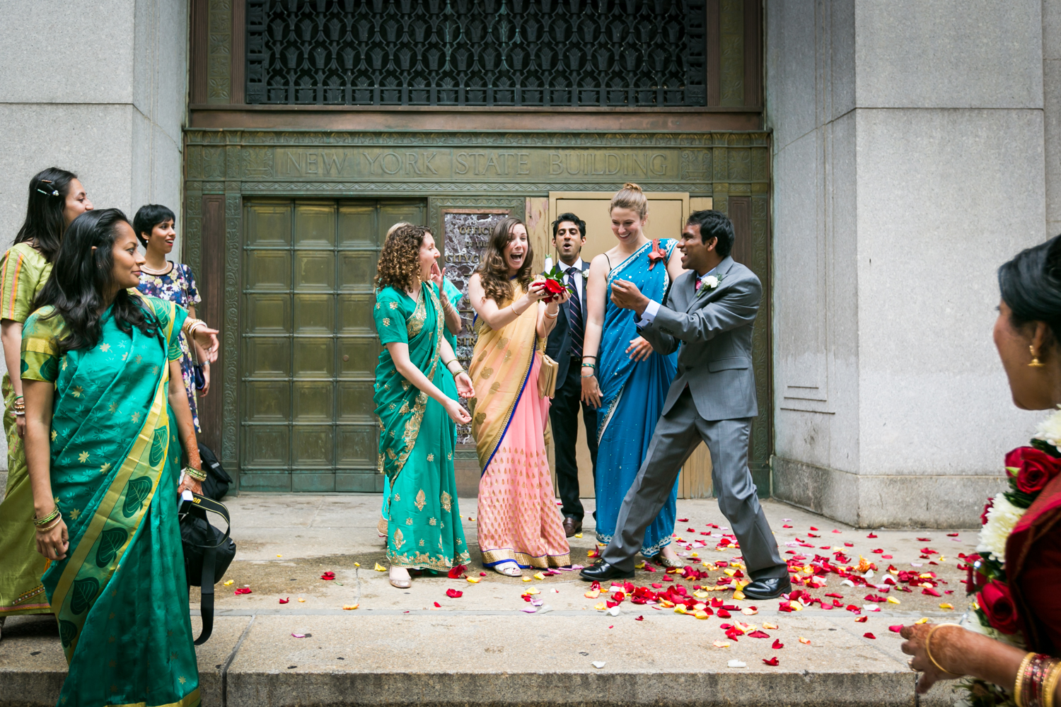 Bridal party wearing saris catching bouquet at a NYC City Hall Indian wedding