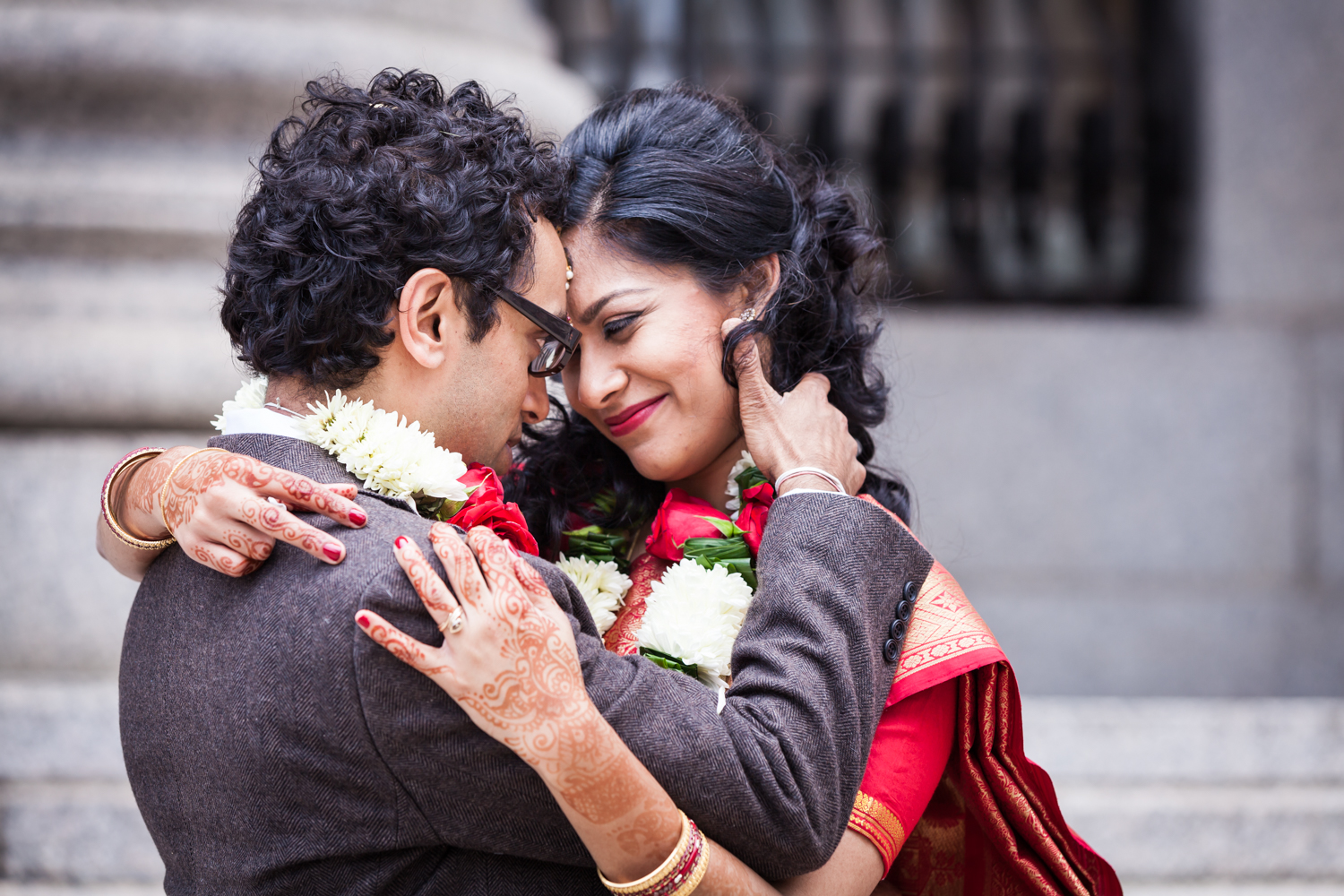 Indian couple hugging after a NYC City Hall Indian wedding