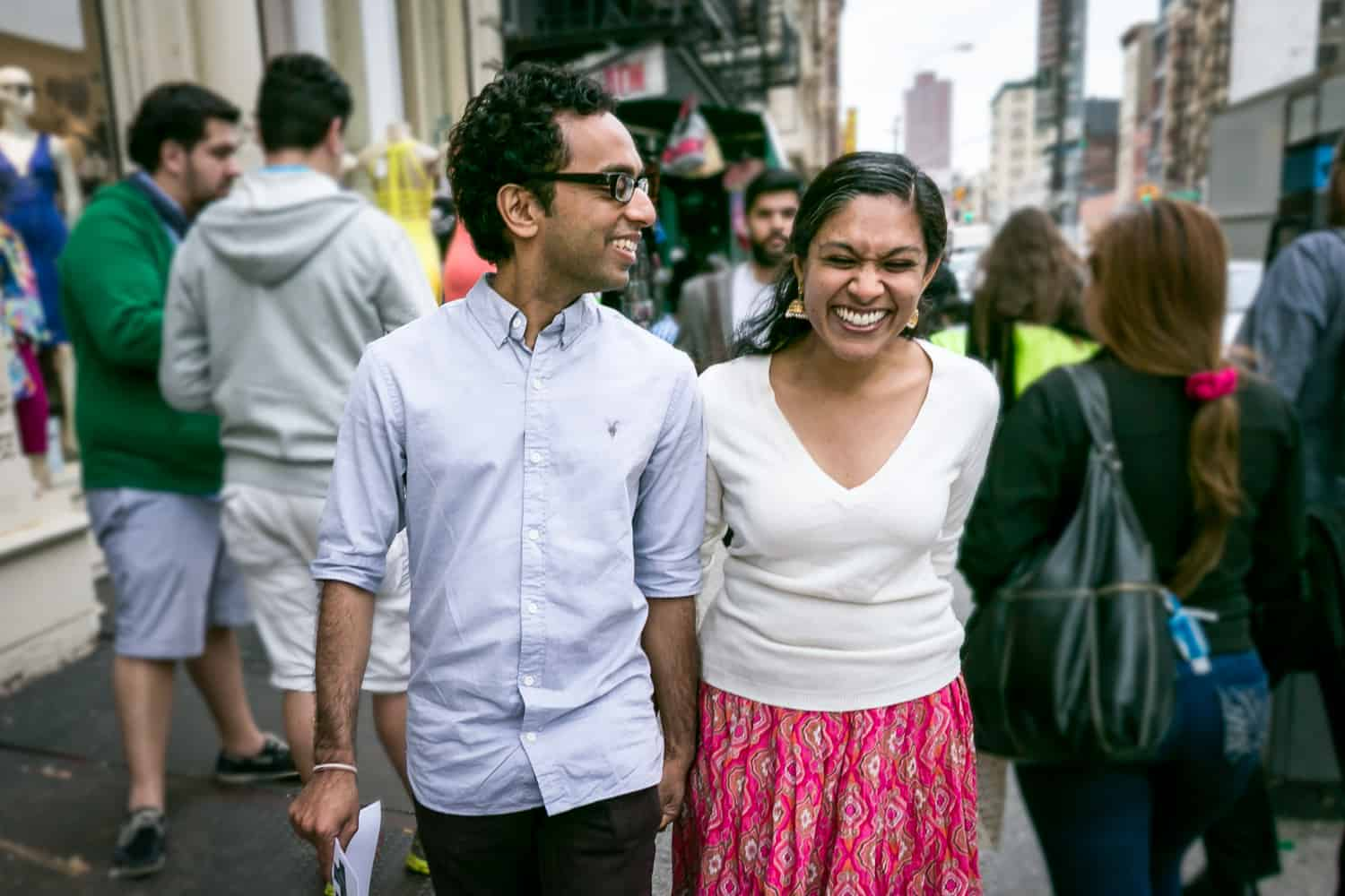 Couple walking on crowded NYC sidewalk