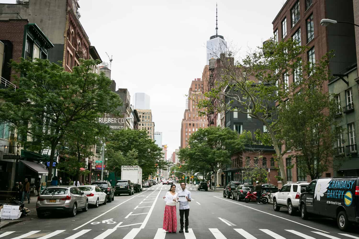 Couple standing in crosswalk of NYC street