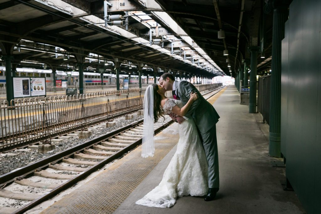 Portrait of the bride and groom inside the Hoboken train station, by Hoboken wedding photojournalist, Kelly Williams