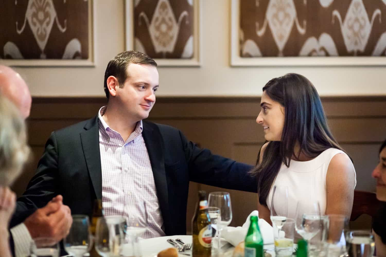 Couple talking at table at a Hoboken rehearsal dinner