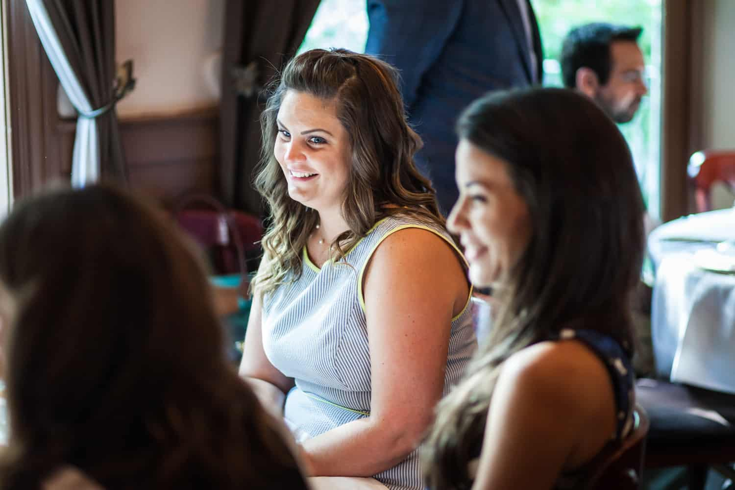 Female guests chatting at a Hoboken rehearsal dinner
