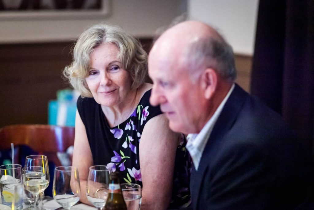 Two older guests chatting at a Hoboken rehearsal dinner