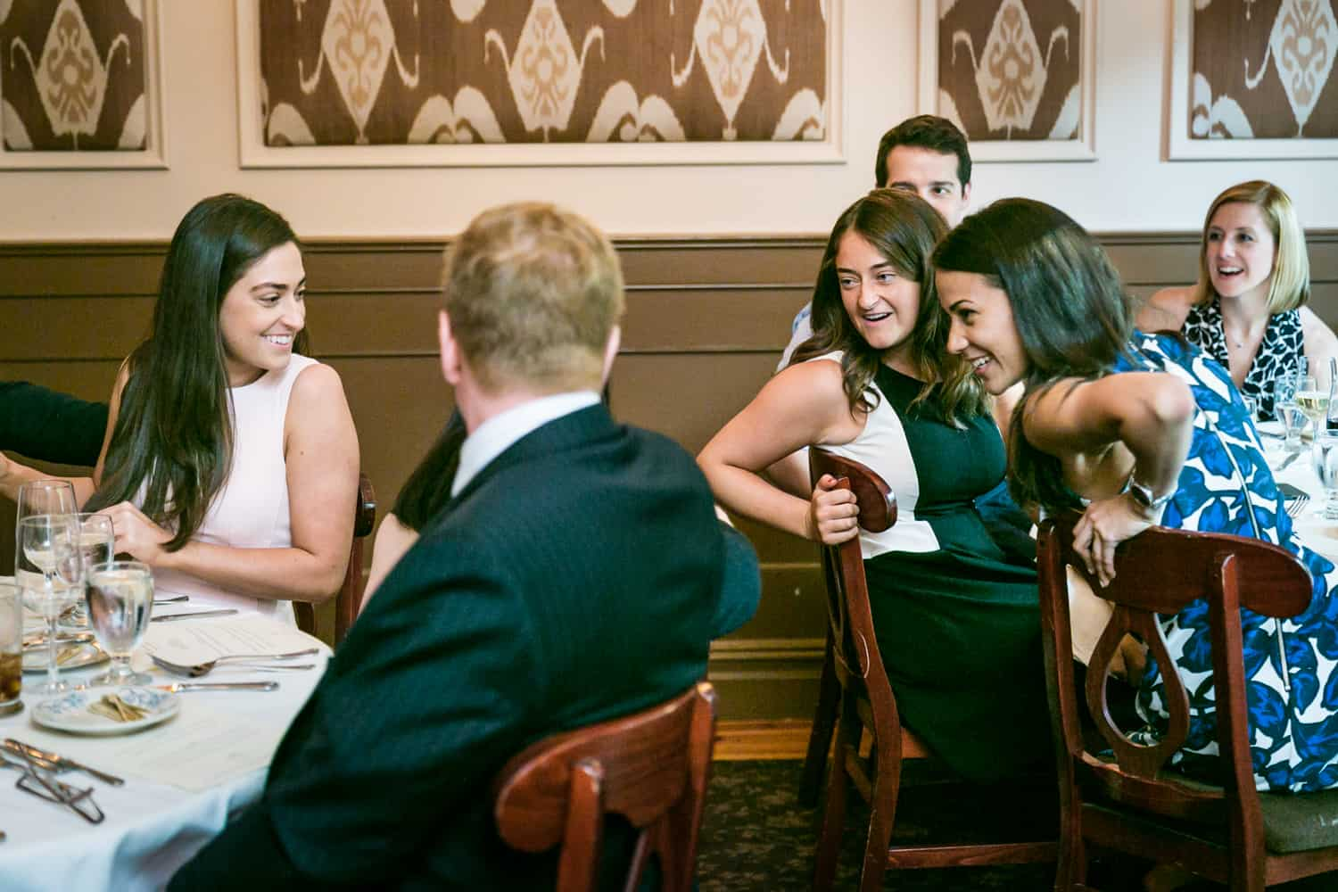 Guests chatting with another table at a Hoboken rehearsal dinner