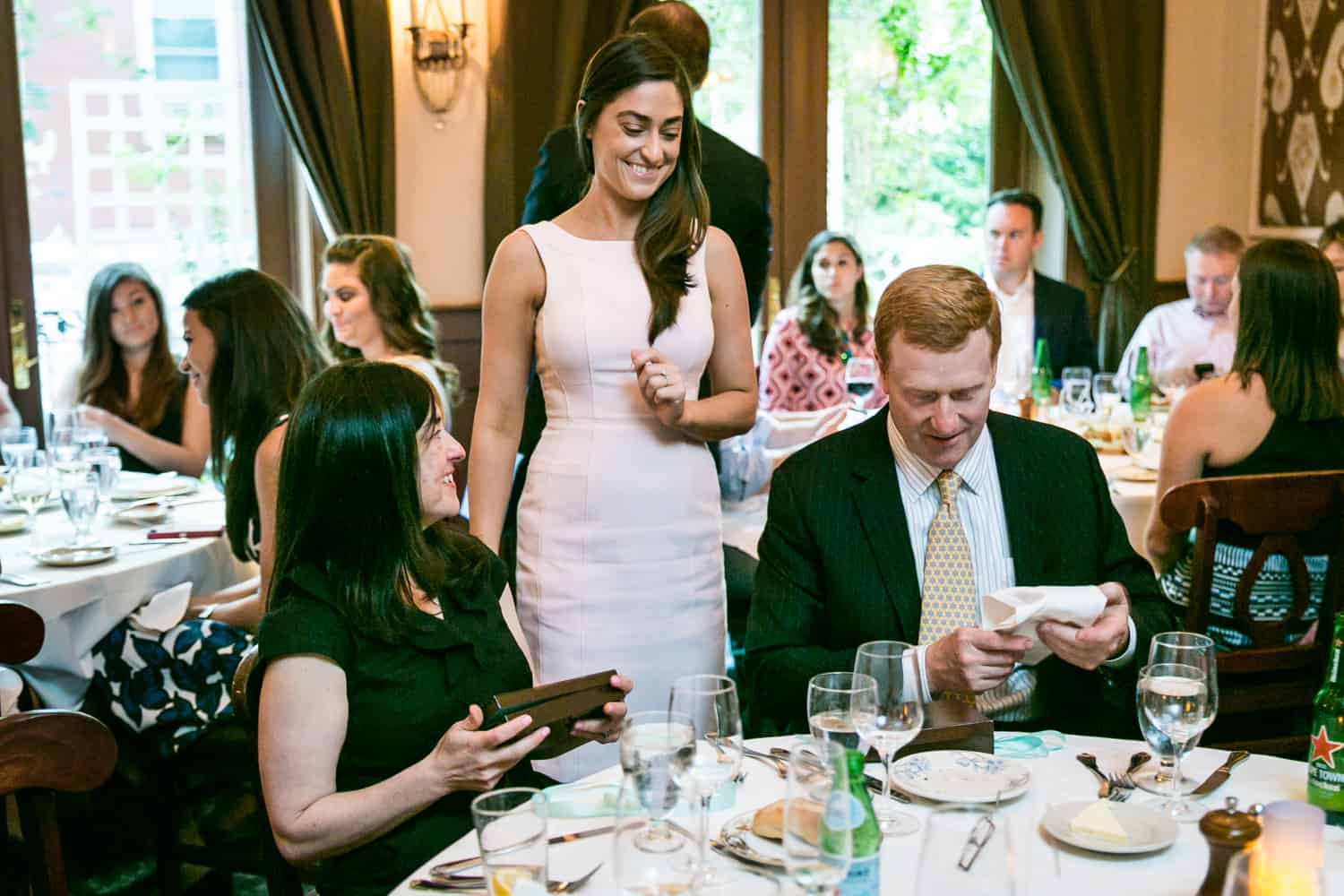 Bride to be giving gifts at a Hoboken rehearsal dinner