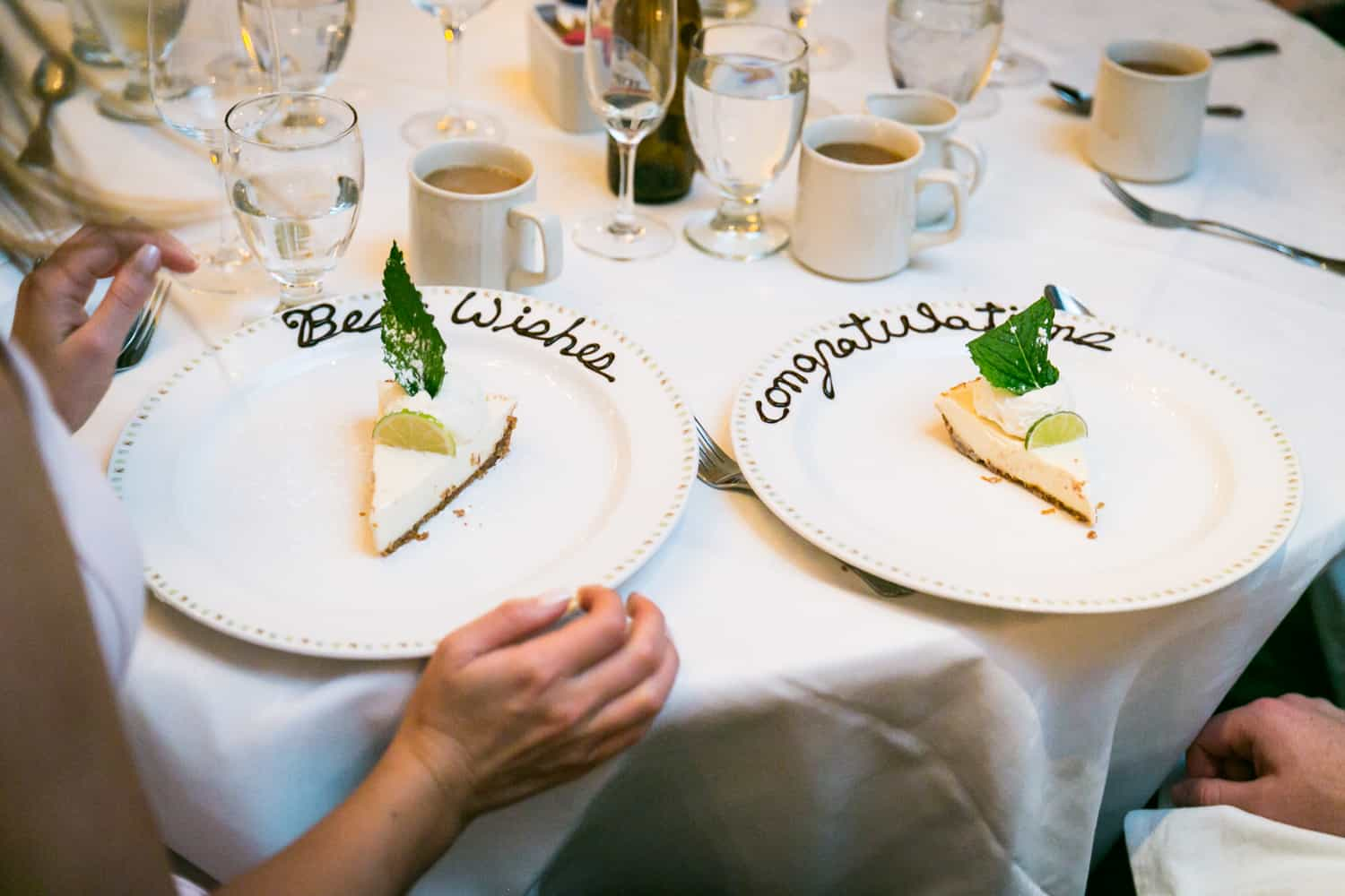Two plates of key lime pie with writing in chocolate