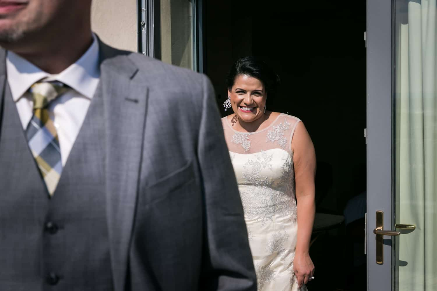 Bride sneaking up on groom before first look