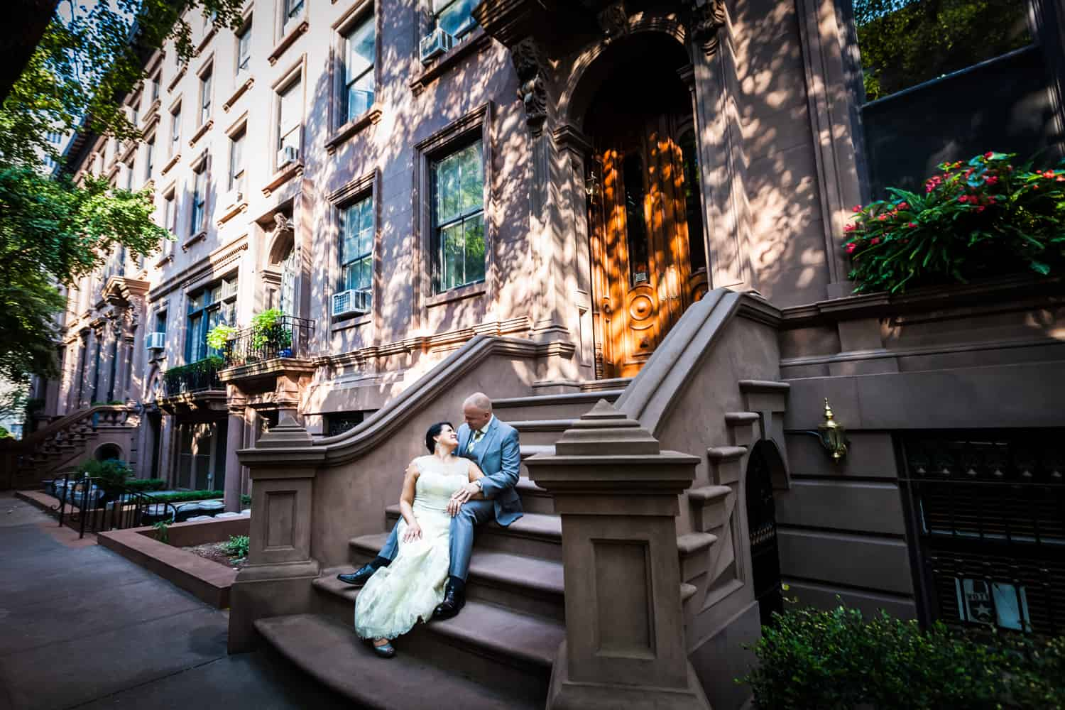Bride and groom sitting on brownstone steps in Brooklyn Heights
