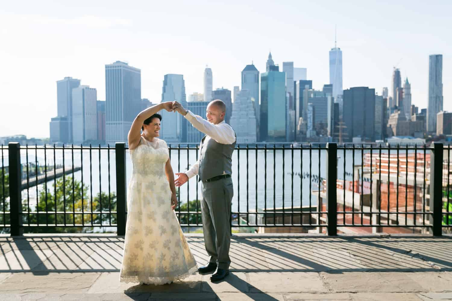 Bride and groom dancing on Brooklyn Promenade