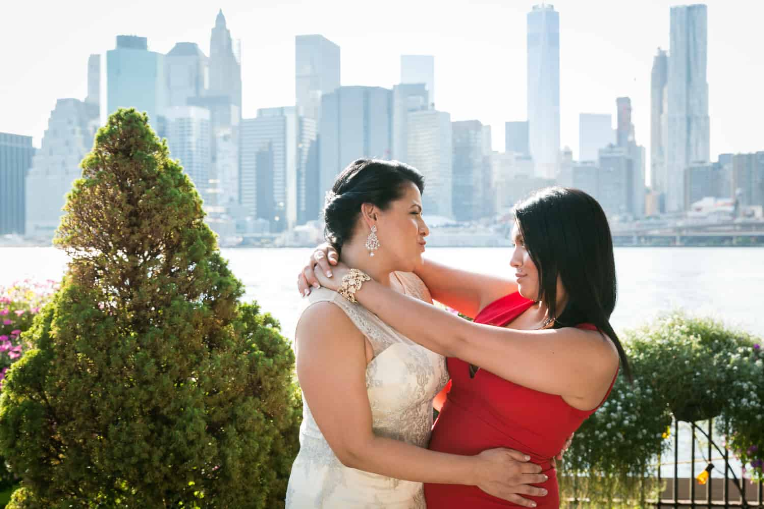Bride and daughter hugging at a River Café wedding in Brooklyn