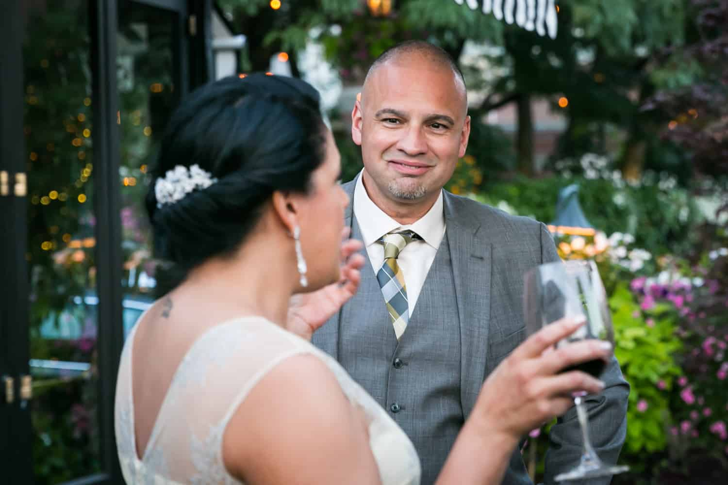 Bride and groom chatting at a River Café wedding in Brooklyn