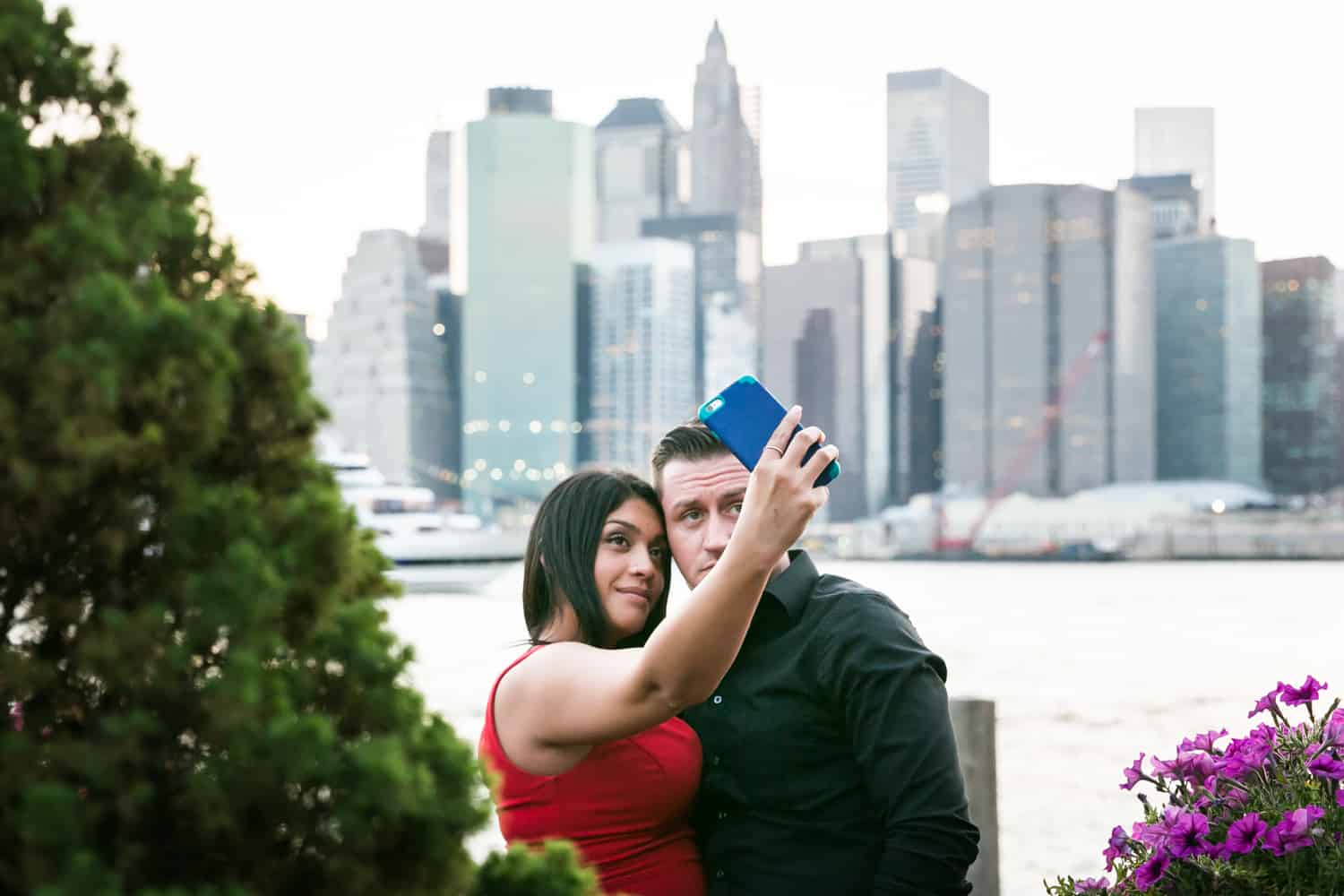 Couple taking a selfie outside at a River Café wedding in Brooklyn