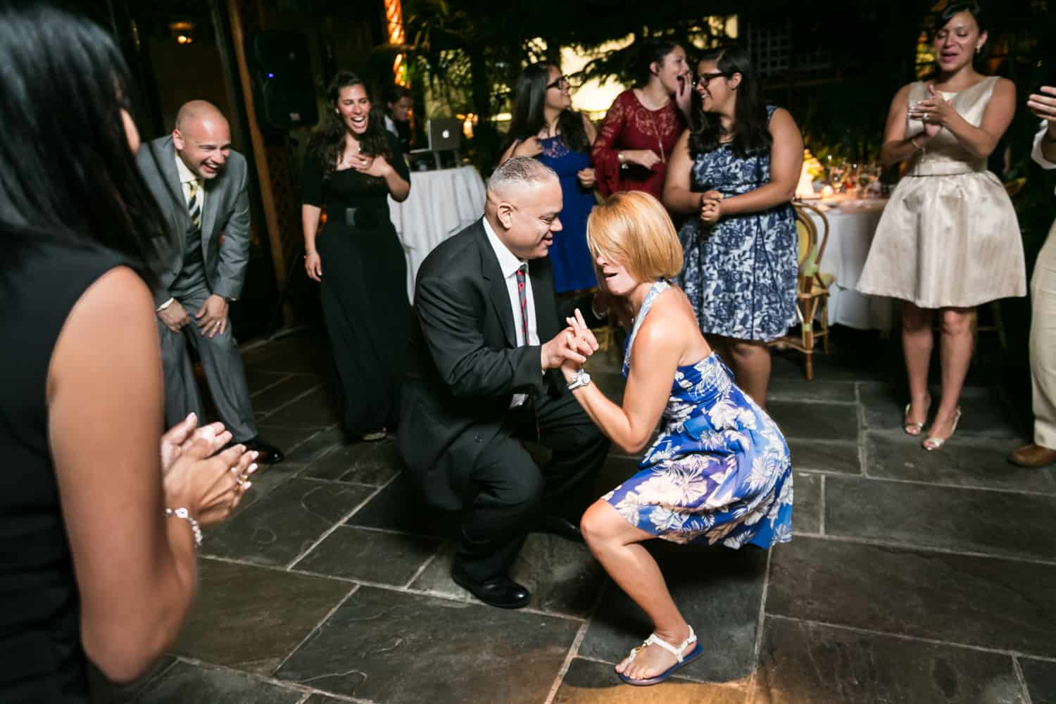 Couple dancing low to floor at a River Café wedding in Brooklyn