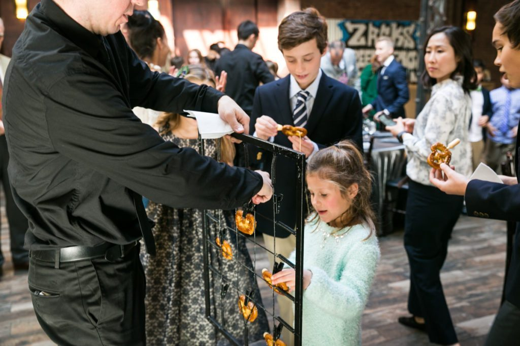 Guests enjoying pretzels at a Brooklyn bar mitzvah at 26 Bridge, by Brooklyn bar mitzvah photographer, Kelly Williams
