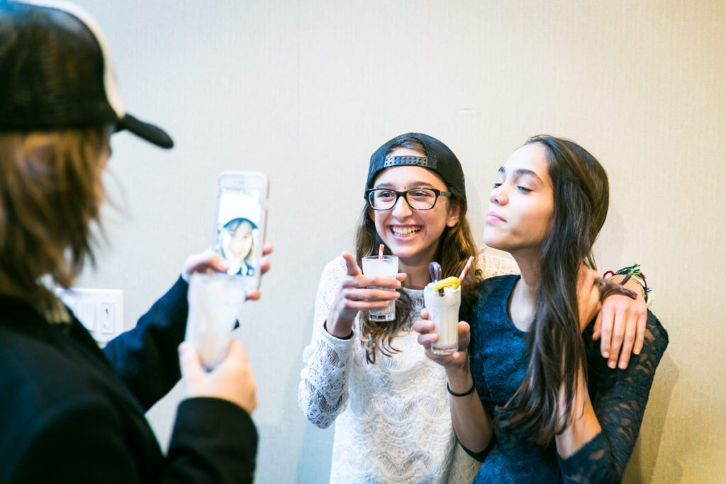 Guests enjoying milkshakes a Brooklyn bar mitzvah at 26 Bridge, by Brooklyn bar mitzvah photographer, Kelly Williams