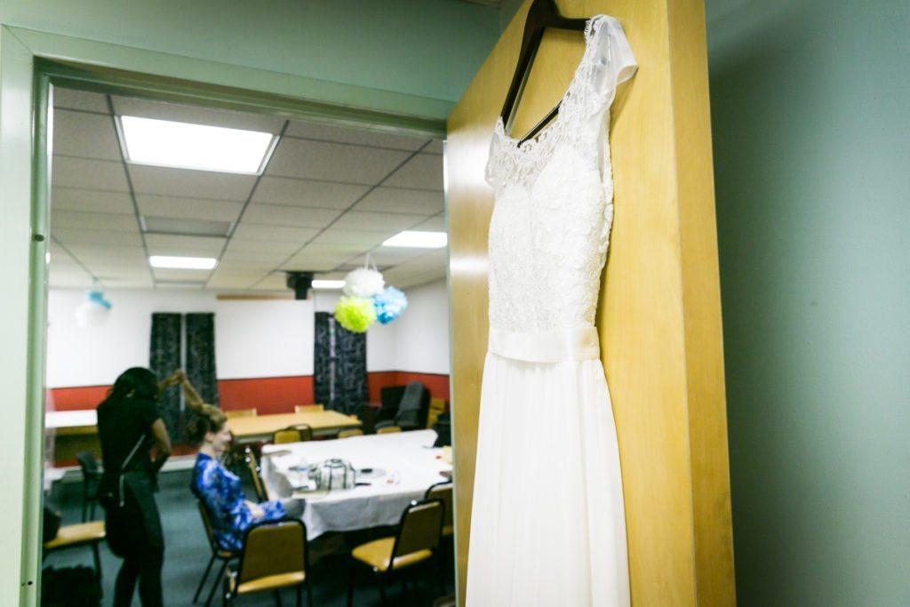 A bride getting ready, by Douglaston Manor wedding photographer, Kelly Williams
