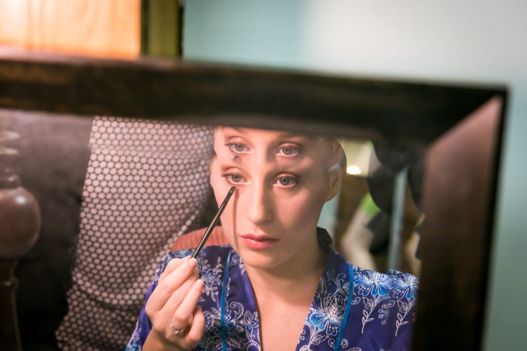 A bride getting ready, by Douglaston Manor wedding photographer, Kelly Williams