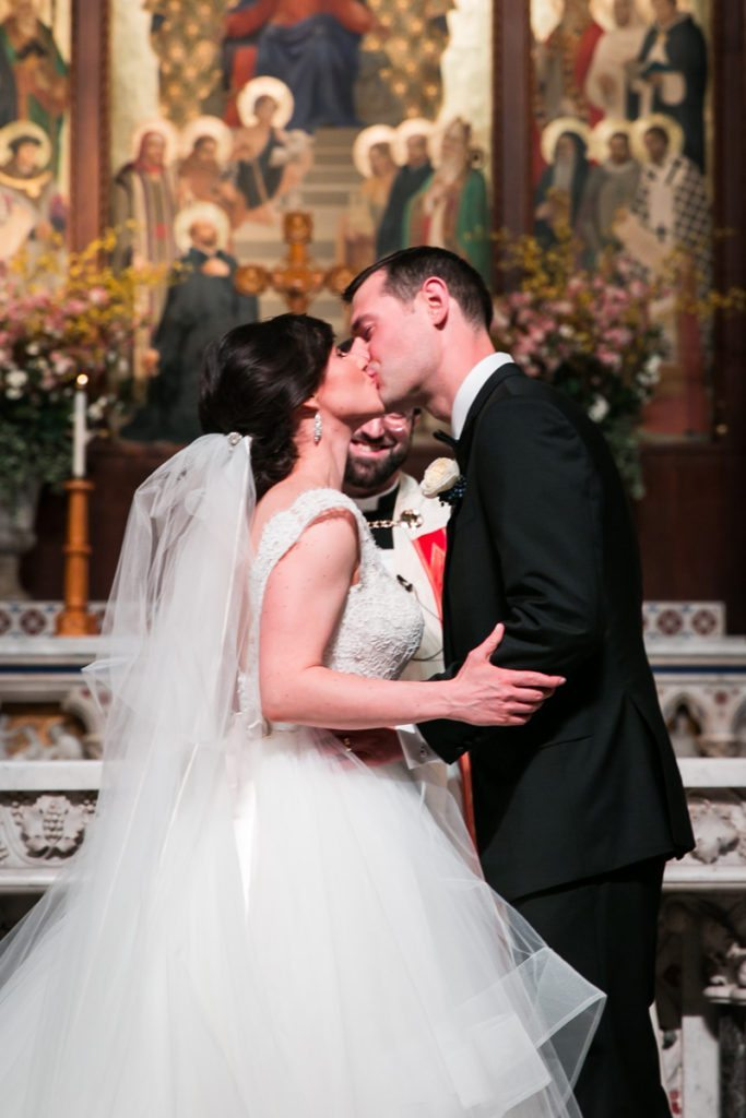 The kiss at a Fordham University Church wedding ceremony