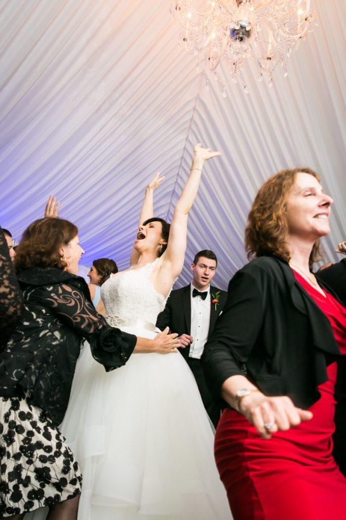 Bride dancing at a Pelham Bay & Split Rock Golf Club wedding reception