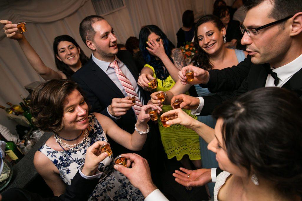 Guests toasting at a Pelham Bay & Split Rock Golf Club wedding reception