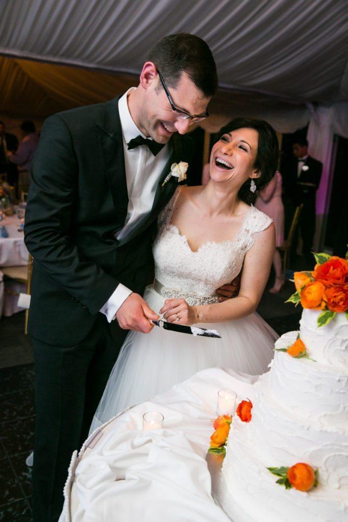 Cake cutting at a Pelham Bay & Split Rock Golf Club wedding reception