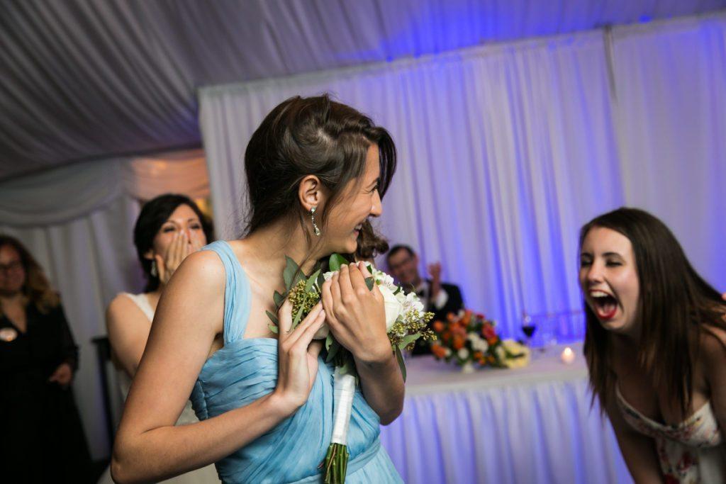 Bouquet toss at a Pelham Bay & Split Rock Golf Club wedding reception