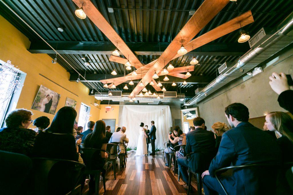 Wide shot of ceremony at an Astoria restaurant wedding