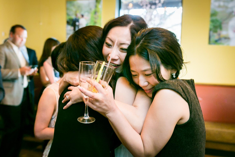 Girlfriends hugging the bride