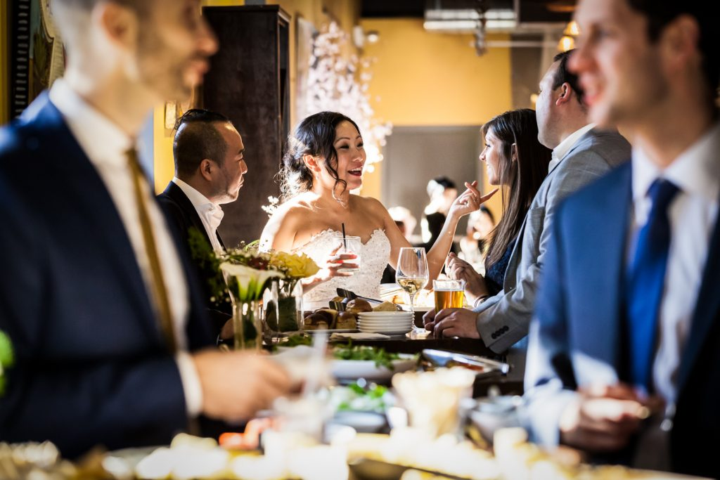 Bride and guests chatting at table at an Astoria restaurant wedding