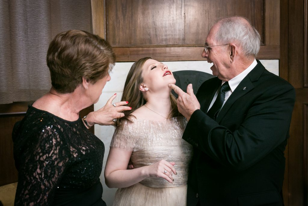 Grandparents touching bride before wedding