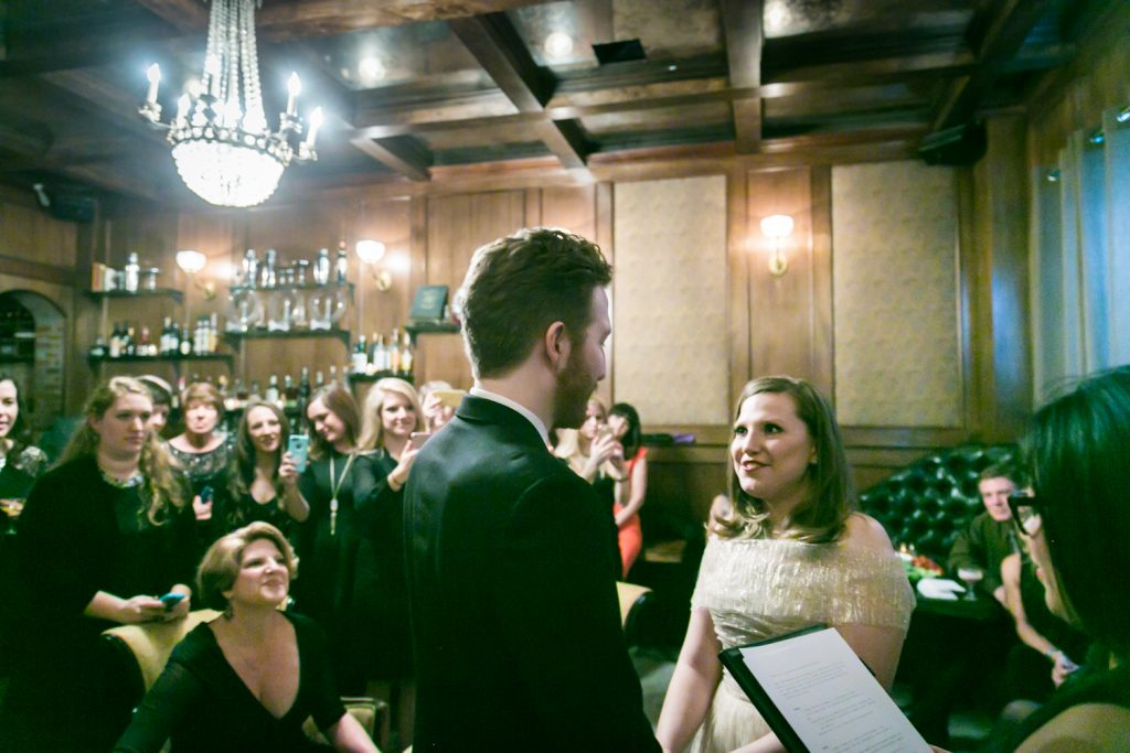 Bride and groom exchanging vows during ceremony at a Clover Club wedding