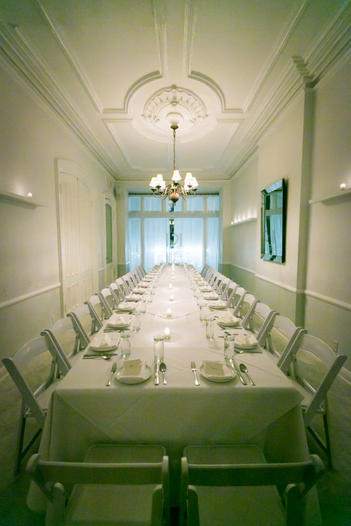 Wide shot of private dining room at Maison May restaurant