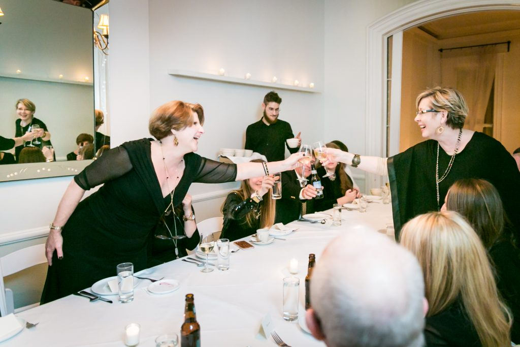 Guests cheering wine glasses during Maison May wedding reception