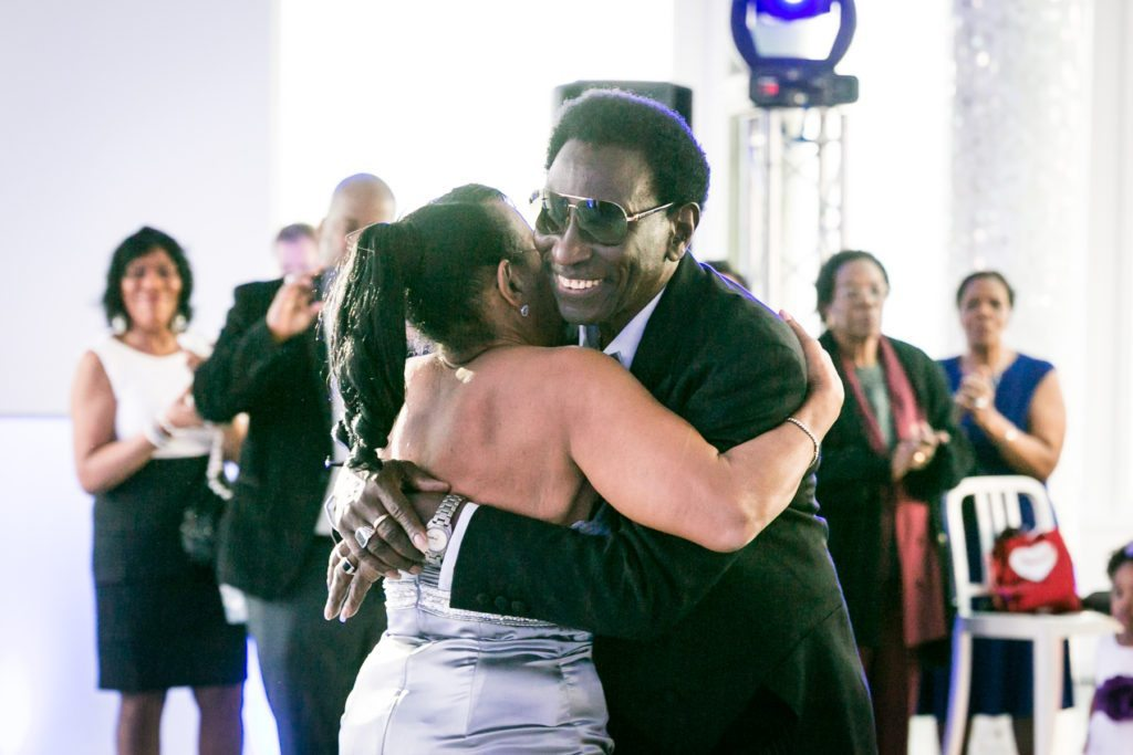 Hugging at an Allegria Hotel party by NYC event photojournalist, Kelly Williams