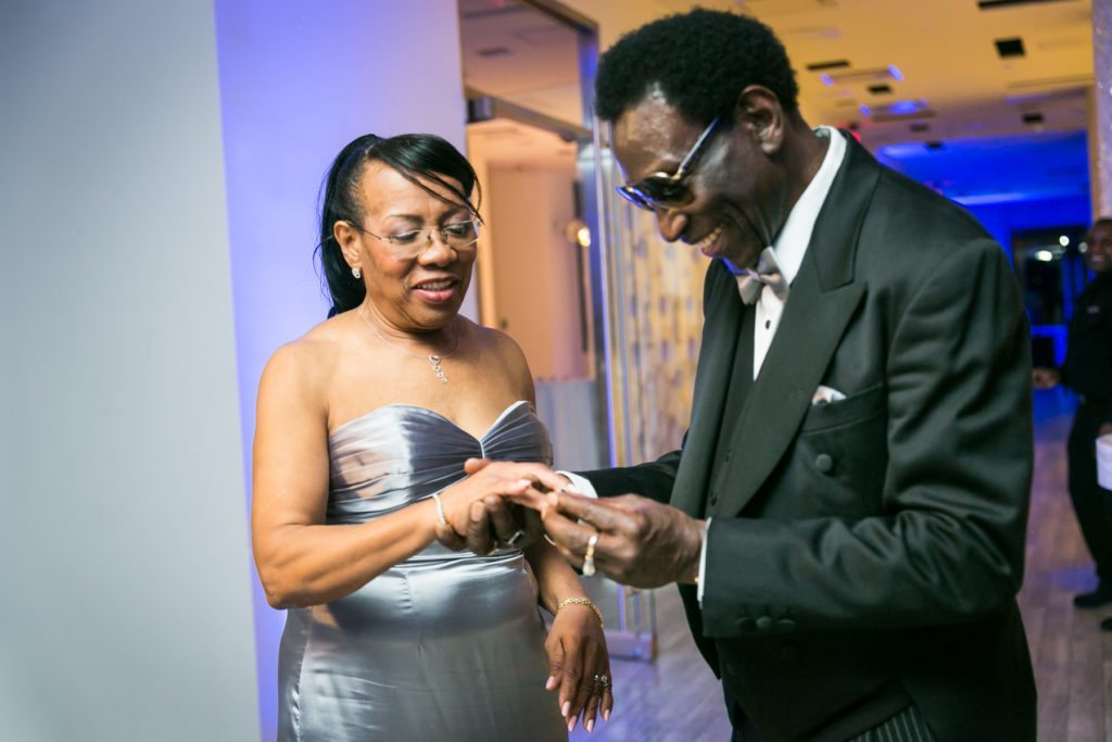 Ring exchange at an Allegria Hotel party by NYC event photojournalist, Kelly Williams