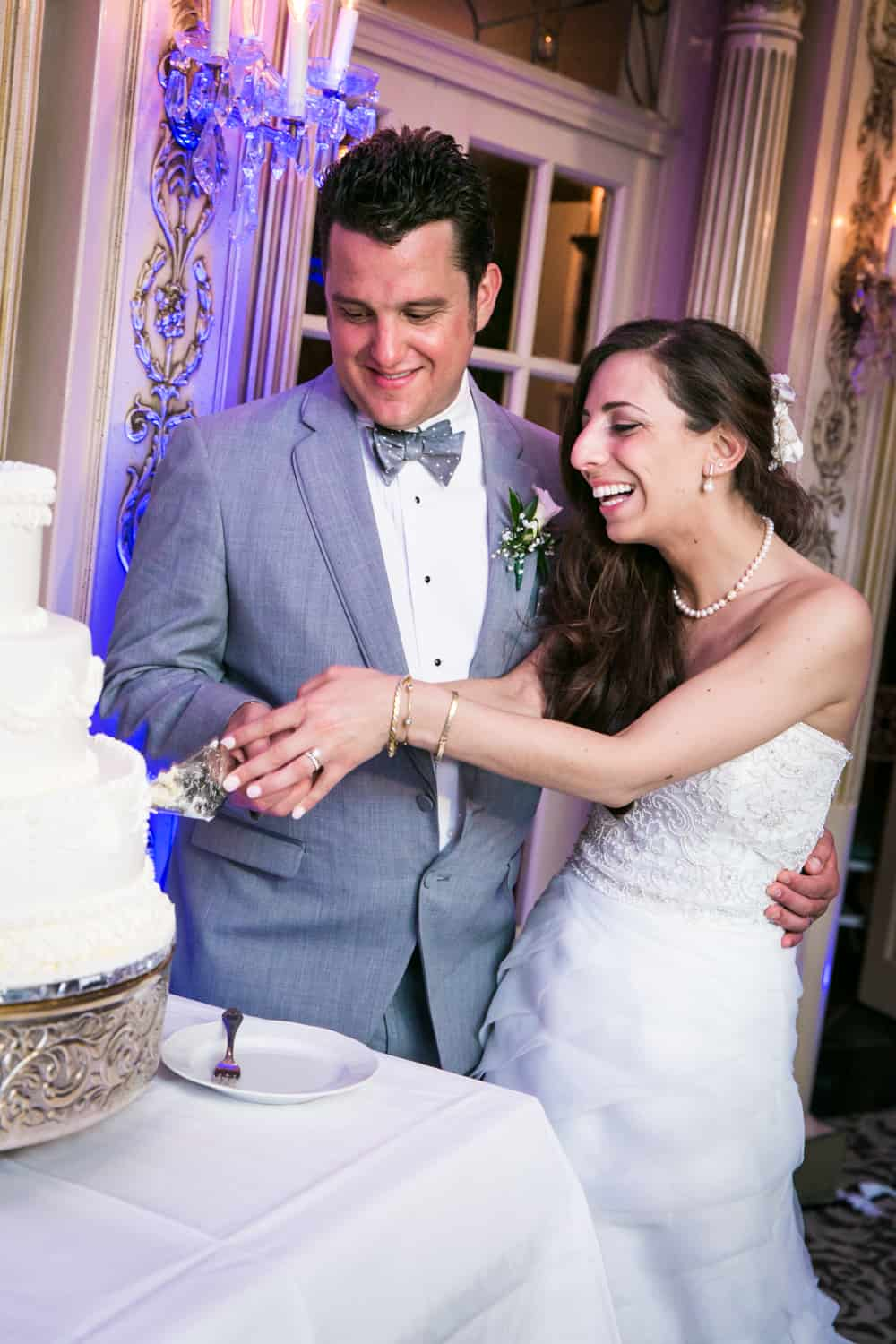 Bride and groom cutting cake at Manor wedding reception