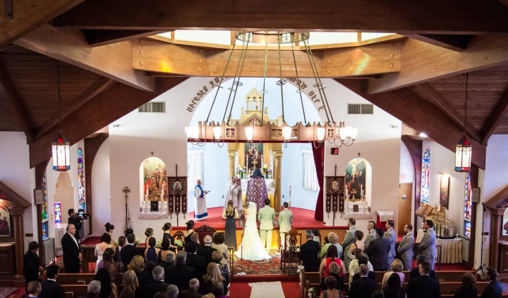 Wide shot of Eastern Orthodox wedding ceremony