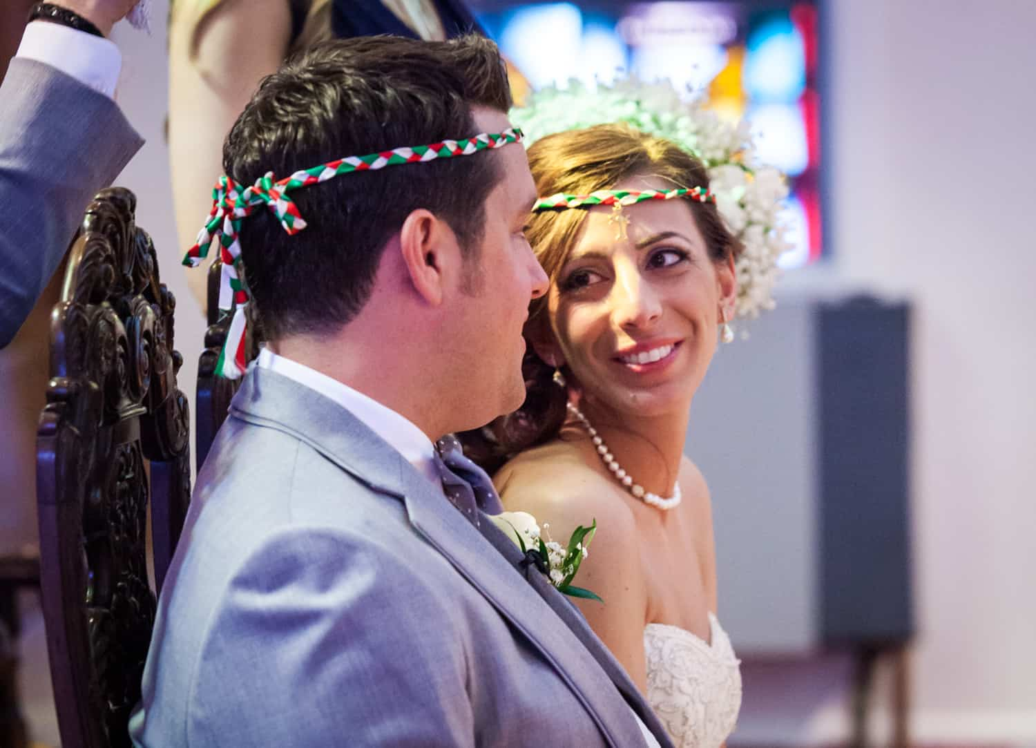 Bride and groom looking at each other in Eastern Orthodox wedding ceremony