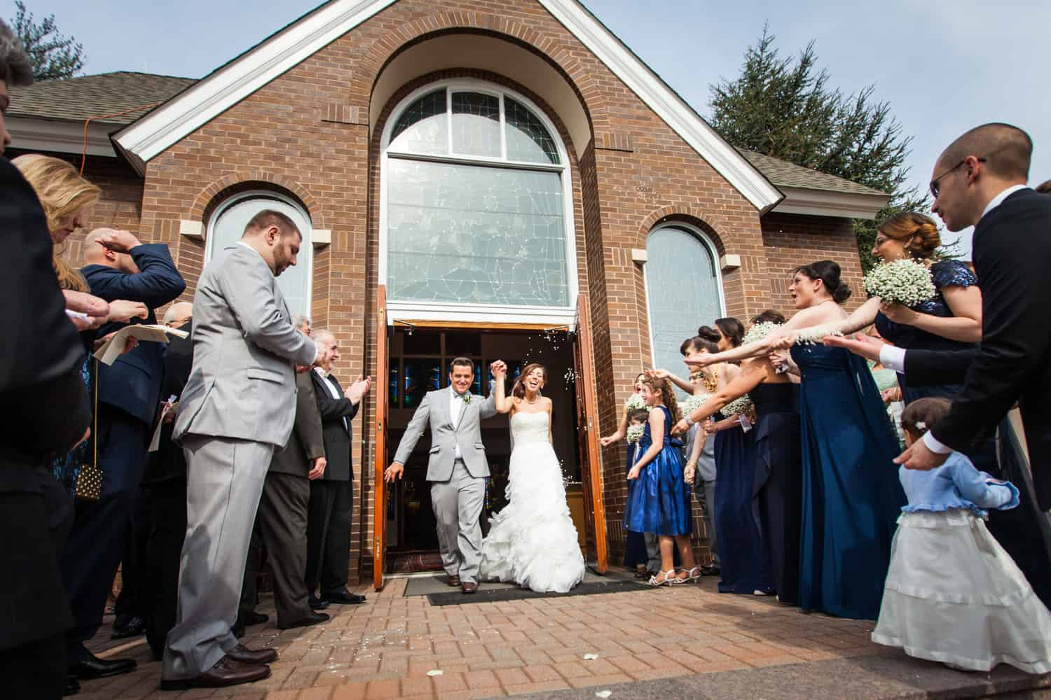 Bride and groom emerging from church after Eastern Orthodox ceremony