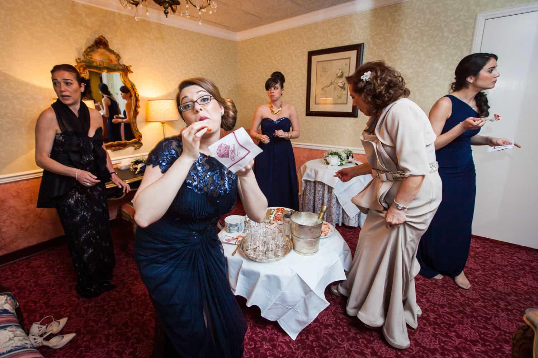 Bridesmaid eating snack in bridal suite