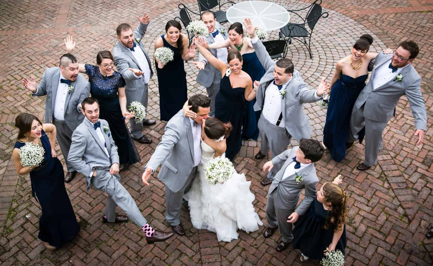 View down on bridal party cheering bride and groom dancing