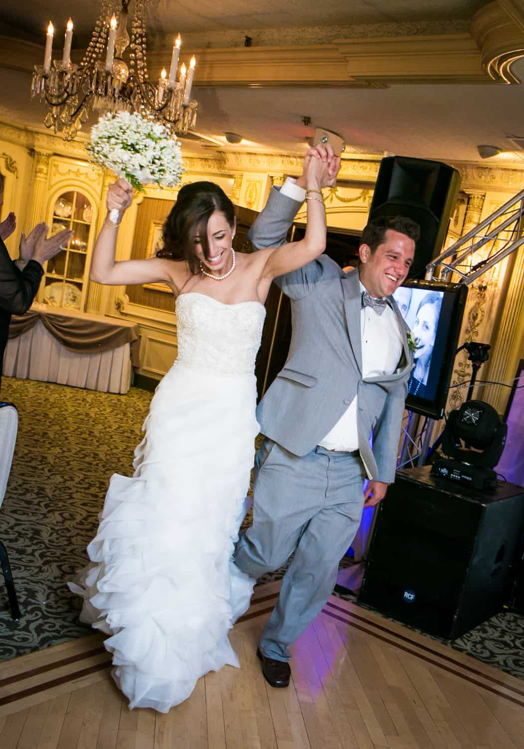 Bride and groom dancing as they enter reception