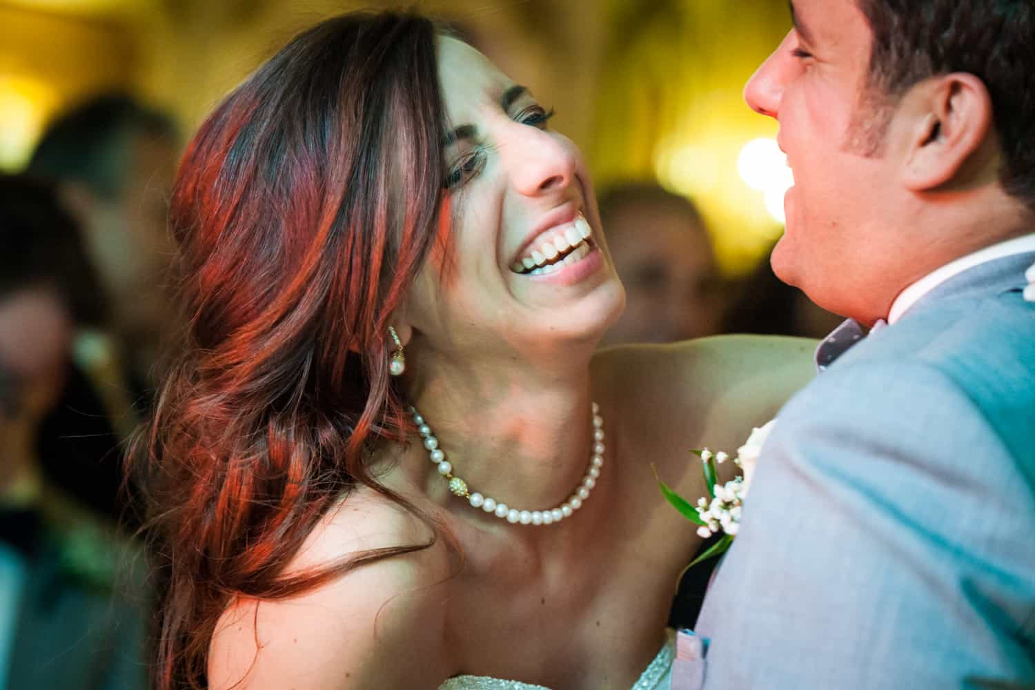Bride laughing during first dance at a Manor wedding reception