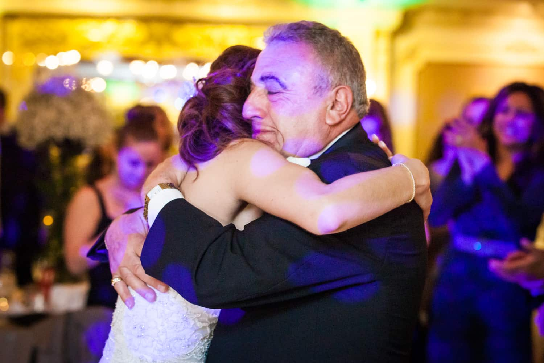 Father hugging bride during Manor wedding reception