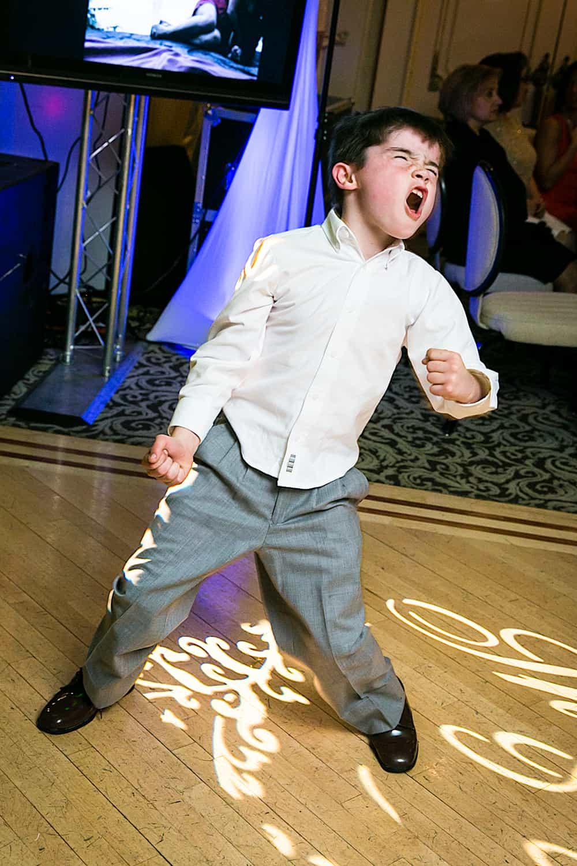 Little boy dancing wildly during Manor wedding reception