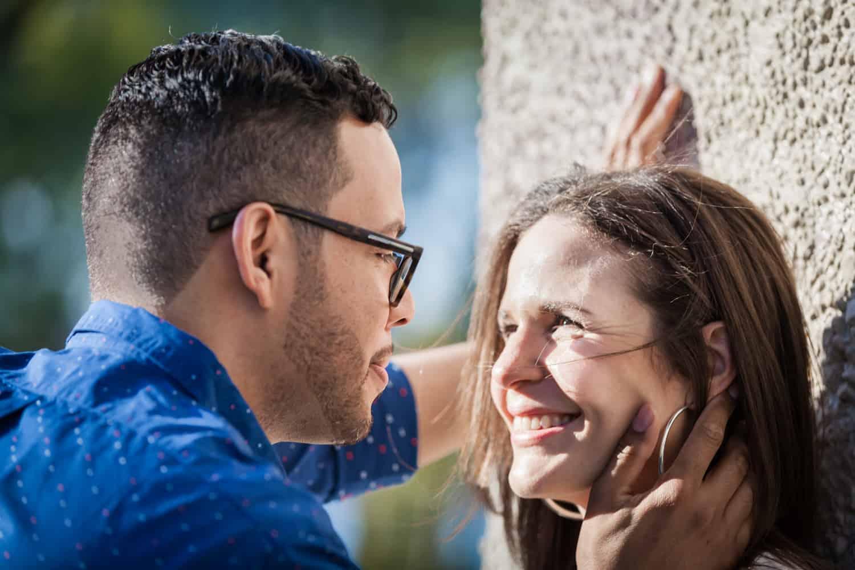 Man touching woman's face during an Astoria Park engagement shoot