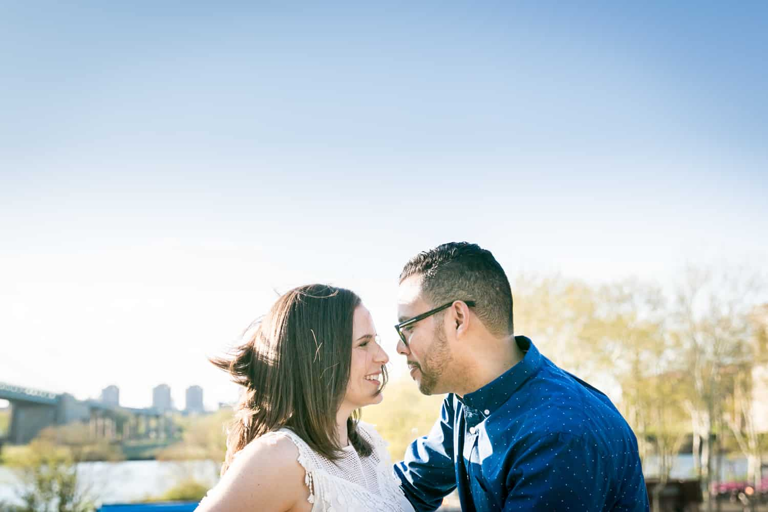 Couple looking at each other during an Astoria Park engagement shoot