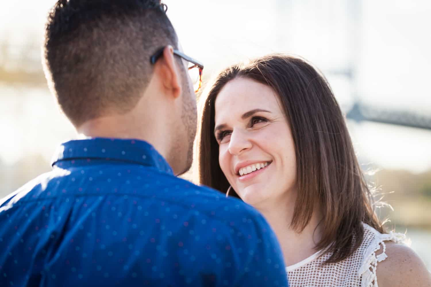Woman looking at man during an Astoria Park engagement shoot