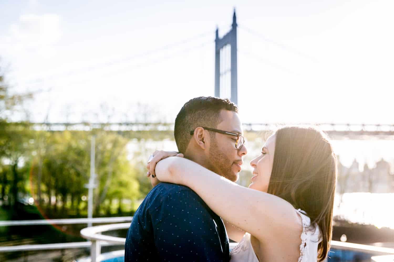 Couple hugging close during an Astoria Park engagement shoot